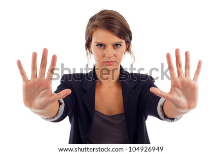 Serious young attractive woman with her hand signaling stop isolated over white background