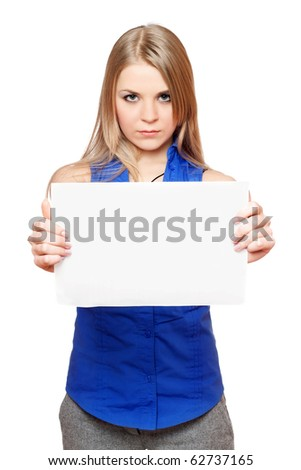 Serious young blonde holding empty white board. Isolated