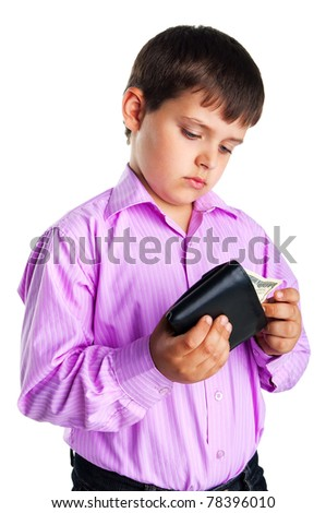 Serious young boy opening leather wallet with one hundred dollars - stock photo