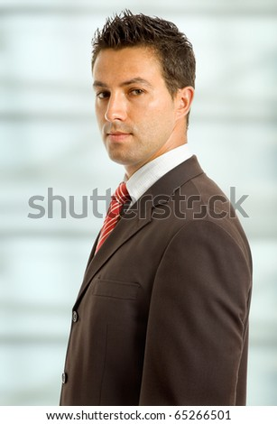 serious young business man close up portrait
