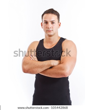 Serious young man against white background
