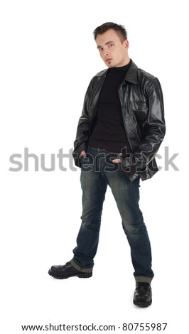 serious young man in leather jacket with hands in pocket