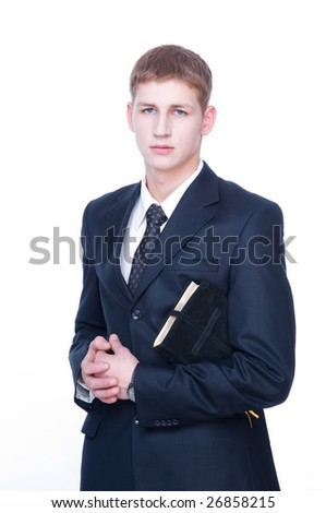 Serious young man with Bible, isolated on white background