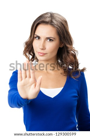 Serious young woman showing stop gesture, isolated over white background