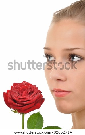 Serious young woman with a rose full of water drops