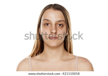 serious young woman without makeup on a white background #421110058