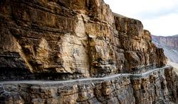 serpentine road in a rock