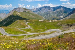 Serpentine road in French Alps.  A mythical stage of the Route des Grandes Alpes with the ascent of the Col du Galibier pass, which connects the Northern and Southern Alps.
