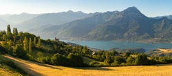 Serre-Poncon Lake in summer with Grand Morgon Peak and Savines-le-Lac village. Hautes-Alpes, Alps, France