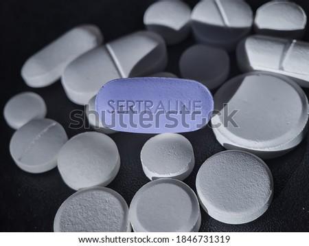 Sertraline blue pill antidepressant of selective serotonin reuptake inhibitor used to treat depressive disorder, OCD, panic disorder, PTSD, premenstrual dysphoric disorder