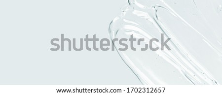 Serum texture, clear liquid gel with bubbles. Cosmetic skin care product sample. Hand sanitizer, alcohol gel background