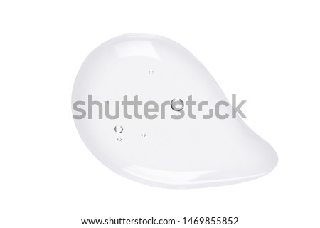 Serum texture. Clear liquid gel with bubbles drop isolated on white background. Close up, macro, top view.