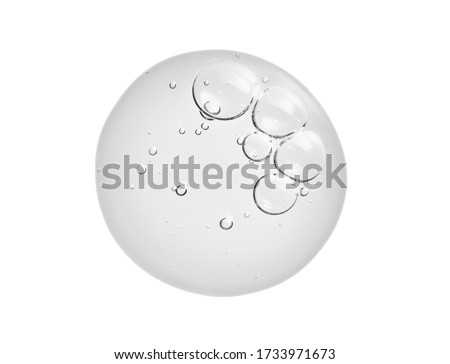 Serum texture. Liquid gel drop with bubbles isolated on white background. Clear skin care cream sample cut out. Transparent liquid beauty product sample close up