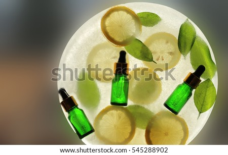 Serum with Vitamin C and lemons ,  lemon leaves in ice. organic cosmetics concept 2 #545288902
