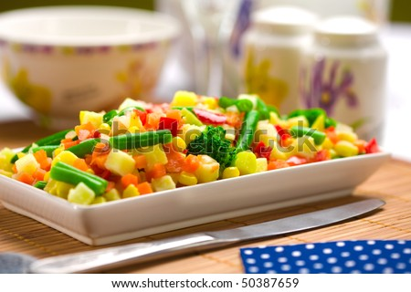Served chopped vegetables mixture. Potato, green bean, broccoli, corn, carrot, onion and sweet pepper.