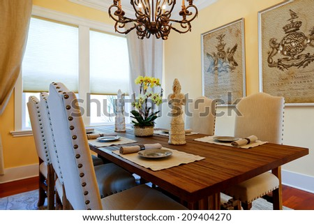 Served dining table with flower and statues #209404270