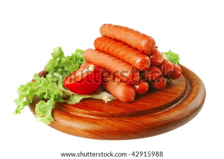 served grilled beef red sausages on wooden plate