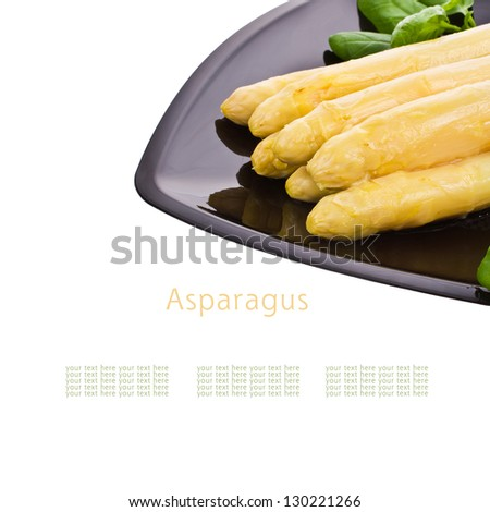 served on a black plate large white asparagus isolated on white background