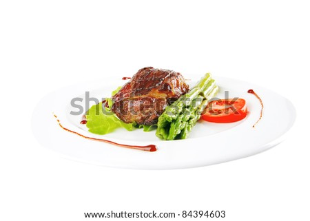 served roasted beef meat with asparagus on white dish