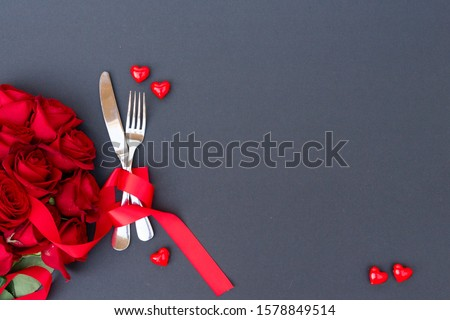 Served table for Valentines Dinne with fork and knife, top view with copy space