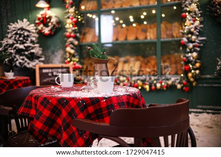 Served table in modern outdoor cafe. Christmas celebration