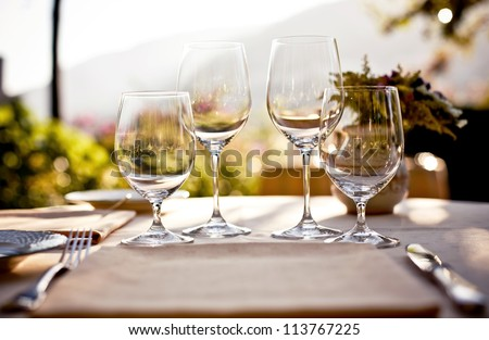Served table set at summer terrace cafe