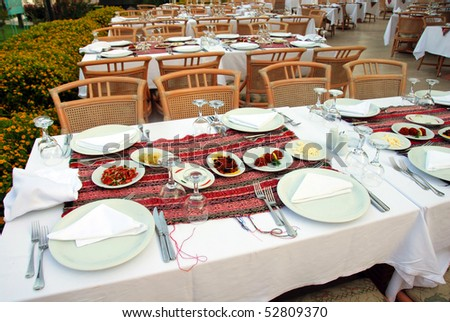 served tables in outdoor restaurant in exclusive hotel, Turkey