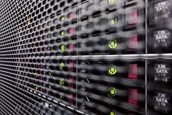 Server hard drives SATA. Internet server in datacenter close-up view. Hard drives in a computer rack