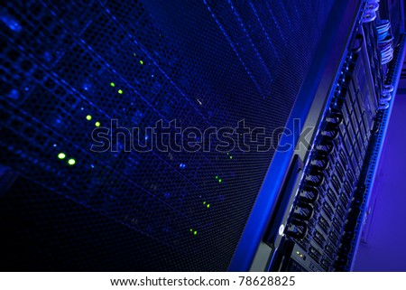 Server rack cluster in a data center (shallow DOF; color toned image)