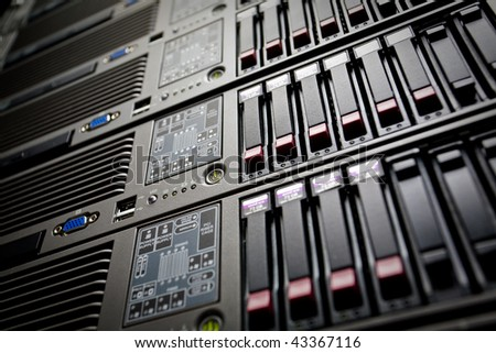 Servers stack with hard drives in a datacenter - stock photo