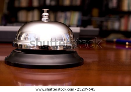 Service Bell on Desk with Pen and Keyboard Background.  Shallow DOF.