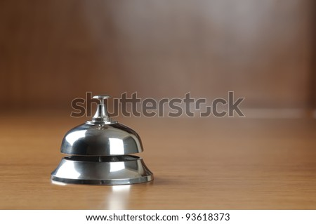 service bell on the hotel reception desk with copy space