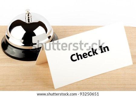 Service Bell with Check In Sign at Hotel Desk