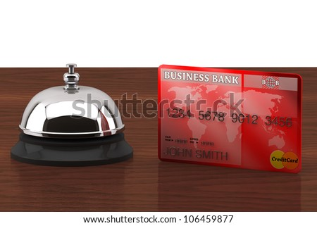 Service bell with Credit Card on a wooden desk
