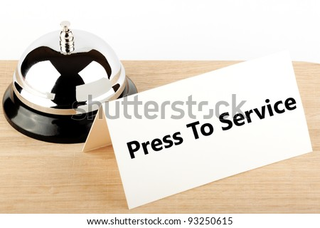 Service Bell with Service Sign at Hotel Desk