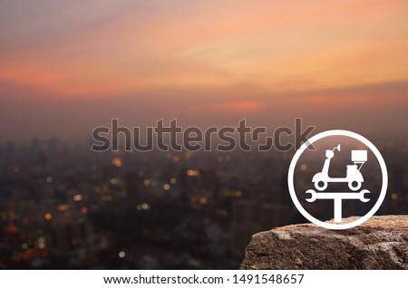 Service fix motorcycle with wrench tool flat icon on rock over blur of cityscape on warm light sundown, Business repair motorbike concept #1491548657