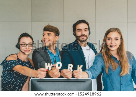 Service phone operators use headset and computer, focus on people answers incoming telephone calls directing to appropriate department, takes messages from clients, assistance distantly concept