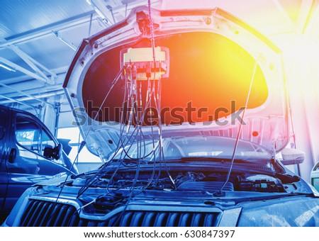 Service station. Car repair wiring. Engine. Background #630847397