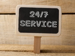 Service 247  text write on Chalkboard at wooden background