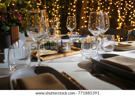 service with silverware and glass stemware for an event party #771885391