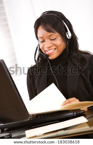 Service: Woman Looks Through Documents At Desk