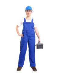 Service woman wearing blue helmet and overall holding black toolbox over white