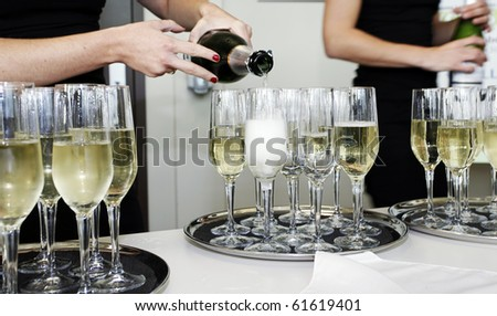 serving champagne at a party