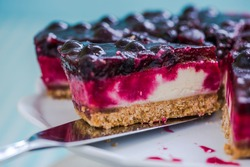 serving cheesecake with black forest fruits, taste of summer