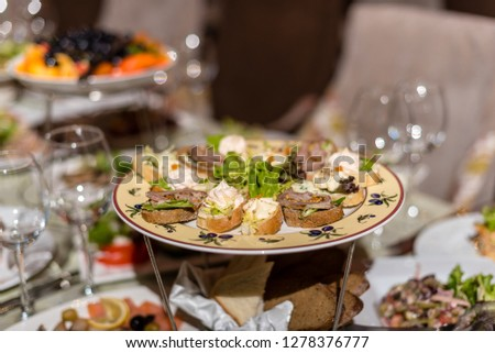 Serving dishes in the restaurant. luxury dinner served on the table #1278376777