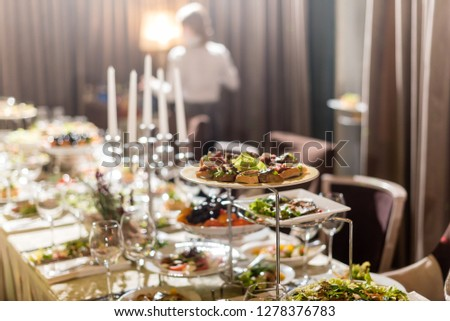 Serving dishes in the restaurant. luxury dinner served on the table #1278376783
