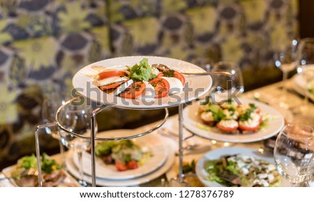 Serving dishes in the restaurant. luxury dinner served on the table #1278376789