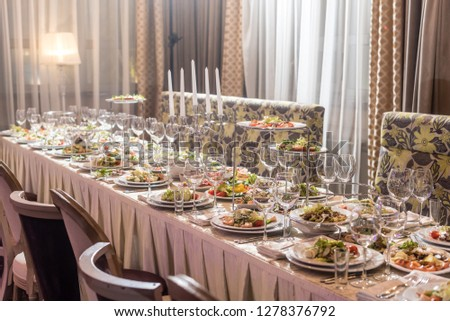 Serving dishes in the restaurant. luxury dinner served on the table #1278376792
