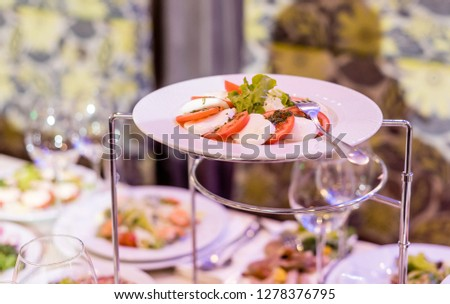 Serving dishes in the restaurant. luxury dinner served on the table #1278376795