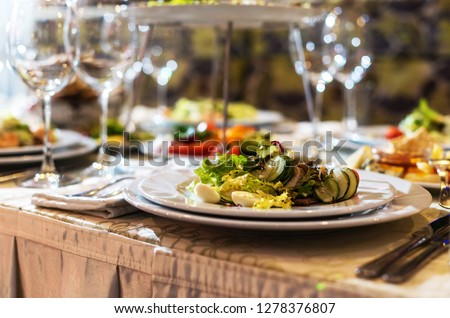 Serving dishes in the restaurant. luxury dinner served on the table #1278376807